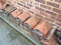 Approximately 40 reclaimed vintage triangular terracotta coping stones
