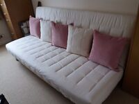 3 seatersofa bed with sprung mattress and underneath storage .