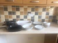 Set of dishes, saucepans and grill pan