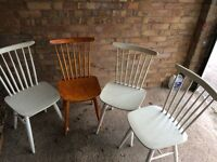 Four Wooden spindle back chairs