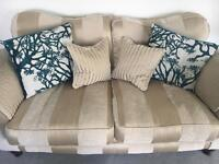 Gold 2 seater sofa with cushions included