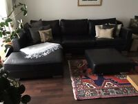 Black leather corner sofa with footstool for sale