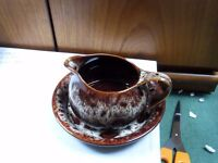 A fosters pottery gravy boat and saucer