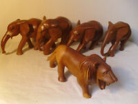 COLLECTION OF 4 WOODEN ELEPHANTS & WOODEN LION