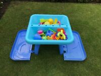 ELC Sand and Water Table. In Good Condition. Selling with lots of sand and water toys.
