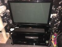 "Panasonic 42"" plasma with black glass stand and Panasonic Sound bar"