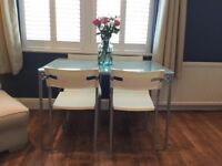 Idea Glass Dining Table and Four Chairs