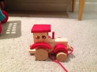 Various baby/toddler toys: Thomas tank engine, wooden tractor, dumper truck, little toy fire engine