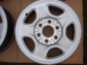 "4 - Chev/GMC 1500 Silver steel OEM 16""x 6 bolt rims / no tires"