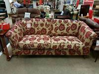 Gold and red flock sofa