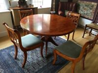 Solid Yew Dining Table and 6 chairs, excellent condition. Extends to oval shape.