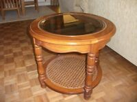 ROUND COFFEE TABLE 25 INCHES ROUND AND 22 INCHES HIGH INSET GLASS TOP WITH RATTAN SHELF BELOW