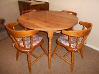 'Solid wood' table and chairs