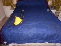 Inflatable double mattress with foot pump.