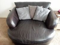 LARGE LEATHER CUDDLE CHAIR & STORAGE FOOTSTOOL.