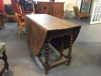 A 19th century carved country oak gate leg - drop leaf dining table