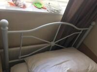 White single frame with mattress