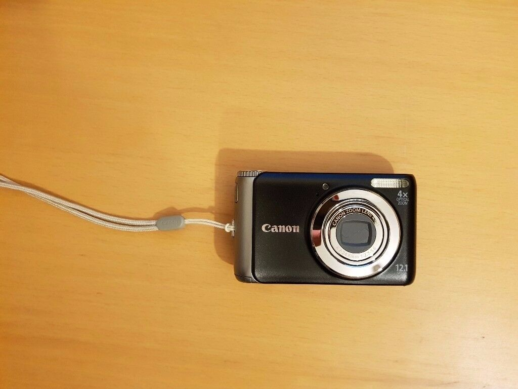 Cannon A3150 power shootcammera with charger battery and three sd cards