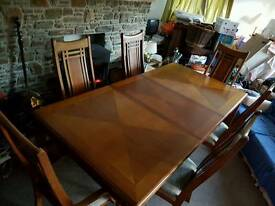 Large extending dining table with chair set