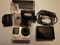 GoPro Hero 4 Black (4K) with touch screen and case.