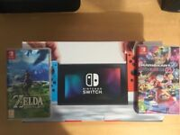 nintendo switch, neon red ! all boxed as new ! 2 games ,mariokart & zelda ! price stands ,no offers