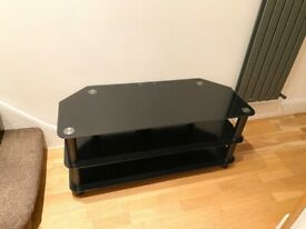 3 TIER BLACK GLASS TV STAND SIZE L:105CM W:45CM H:48CM EXCELLENT CONDITION £30 NO OFFER CAN DELIVER