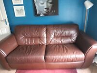 2 brown leather sofas, a 3 seater and a 2 seater