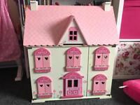 Large rosebud dolls house with furniture