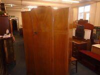 large lightwood vintage wardrobe.
