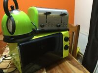 Lime green kettle, toaster and microwave