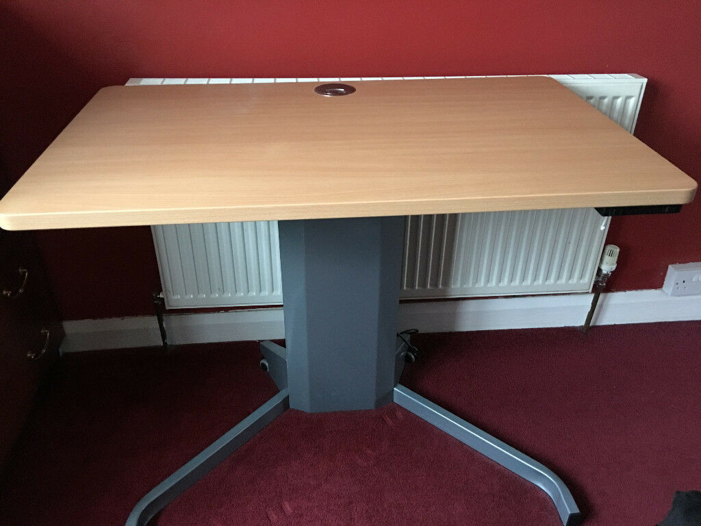 Height adjustable electric sit to stand desk disability