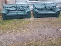 Comfy green leather sofa suite,pair of large 2 seaters, can deliver