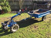 Two wheel garden rotavator with implements