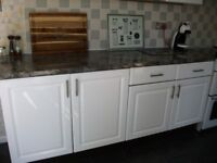 2x wall and 2x base kitchen/utility units with work top.