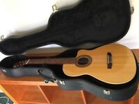 Classical guitar with electric pick up