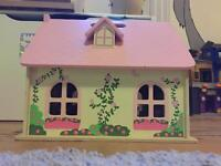 Wooden dolls house with furniture and 2 dolls