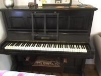 Solid working piano