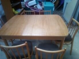 extentable dining table with 6 chairs