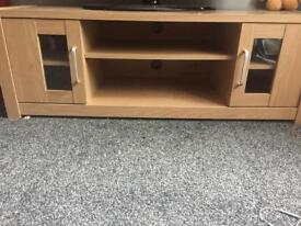 Oak tv cabinet with two doors and shelves