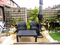 new Rattan effect outdoor seating with large umbrella and umbrella base £110. o.no.