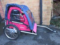 Bike trailer suitable for 2 children.