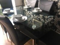 Black glass dining table with 6 chairs
