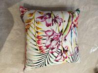 2 vibrant Harlequin fabric cushions
