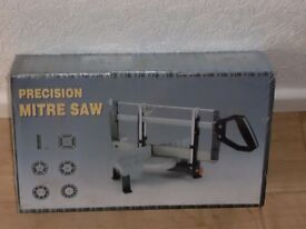 boxed - never used - precision mitre saw - still has plastic wrapping on it