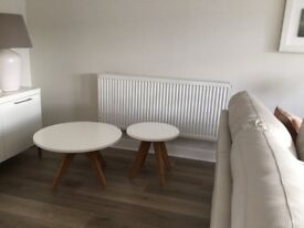 Two M+S coffee tables white top bamboo legs h 40cm + 45cm very good condition