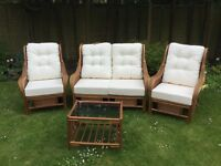 cConservatory three piece suite and table excellent condition