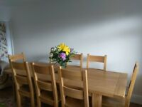 Vancouver Oak dining table and 8 chairs. Beautiful excellent condition. Sale due to d downsizing