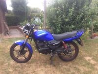 125cc, Low mileage, cheap run around and fun to ride.