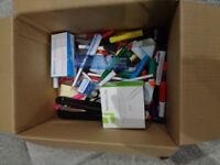 box of stationary pens pencils board markers paper clips stapler high lighters