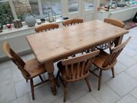 Wooden Kitchen/Dining Table and 6 matching chairs